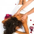 Beautiful woman enjoying massage - Stock Photo