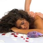 Beautiful woman enjoying massage — Stock Photo