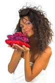 Krásná žena, držící pack spa květiny — Stock fotografie