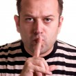 Man showing keep quiet sign - shhh. The concept — Stock Photo