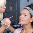 Beautiful girl model, while make-up - Stockfoto