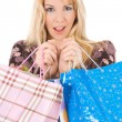 Blond girl with shopping bags — Stok fotoğraf