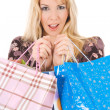 Blond girl with shopping bags — Stock Photo