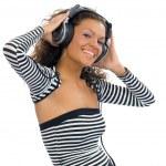 Brunette girl listening music — Stock Photo