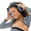 Brunette girl listening music — Stock Photo