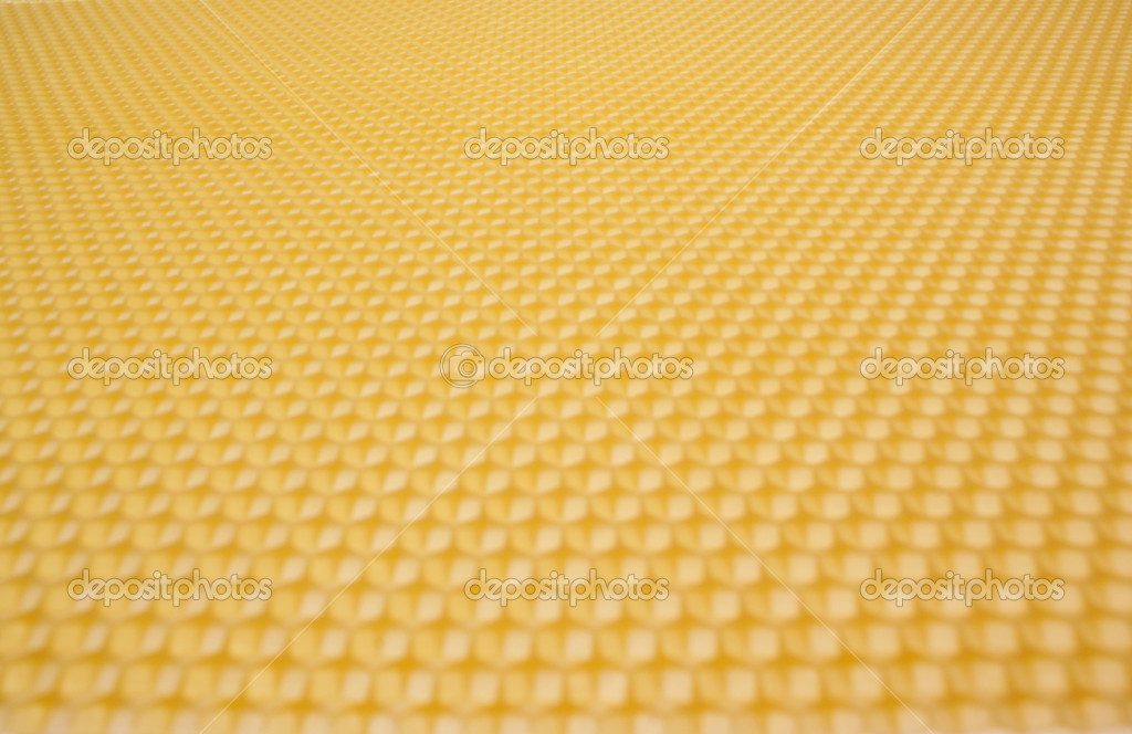 Close up structure of yellow beeswax as background — Foto Stock #1828232