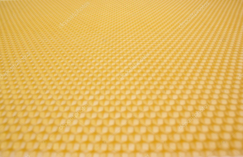 Close up structure of yellow beeswax as background  Foto Stock #1828232
