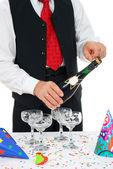 Man unlocks champagne — Stock Photo