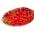 Spoon with red and yellow capsules — Stock Photo