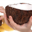 Child hand with coconut — Stock Photo