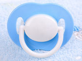 Blue pacifier on towel — Stock Photo