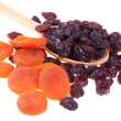 Dried fruits in a wood spoon — Stock Photo