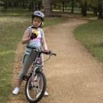 Girl end bike — Stock Photo