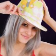 Girl with a cheerful hat — Stock Photo