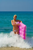 Bikini girl with inflatable — Stock Photo