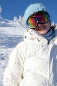 Happy girl in a mountain-skiing — Stock Photo