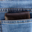 Wallet showing in back pocket of jeans - Stock Photo