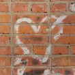 Stock Photo: Graffiti. Heart on a brick wall.