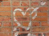 Graffiti. Heart on a brick wall. — Stock Photo