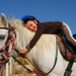 Stock Photo: Little girl and shetland pony