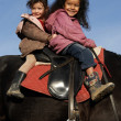Royalty-Free Stock Photo: Two riding little girls