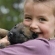 Little girl and puppy — Stock Photo #1859868
