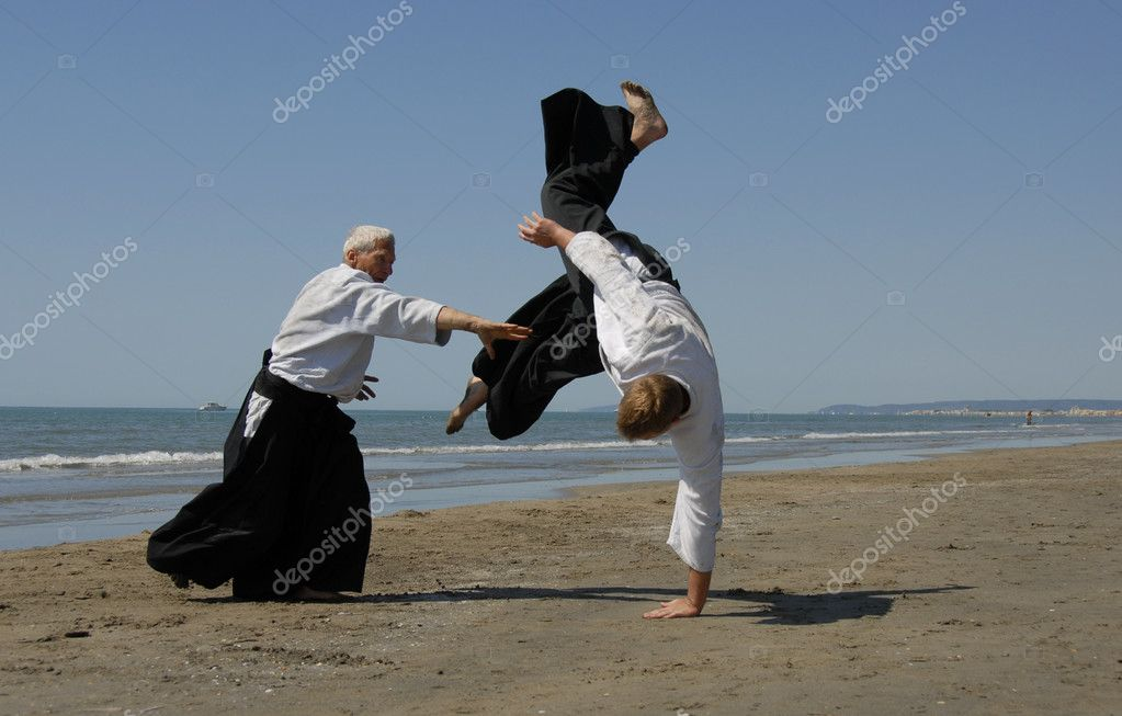 Two adults are training in Aikido on the beach — Stock Photo #1859761
