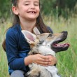 Stock Photo: Little girl and her baby wolf dog