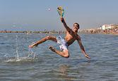 Beach tennis in the sea — Stock Photo