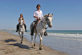 Horseback riding on the beach — Stock Photo