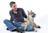 Man and angry wolf — Stock Photo