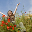 Smiling girl in field — Stock Photo