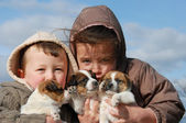 Children and puppies — Stock Photo