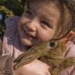 Little girl and bunny — Stock Photo #1892227
