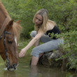 Riding girl in river — Stock Photo