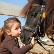 Little girl and her pony — Stock Photo