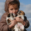 Sad little girl and puppies - Stock Photo