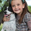 Stock Photo: Little girl and dog