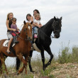 Riding family — Stock Photo