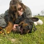 Smiling girl and dog — Stock Photo