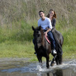 Stock Photo: Riding lovers