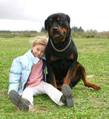 Child and rottweiler — Stock Photo