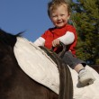 Riding little boy — Stock Photo