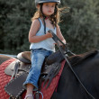Baby riding girl — Stock Photo
