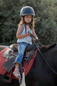 Baby riding girl — Stock Photo