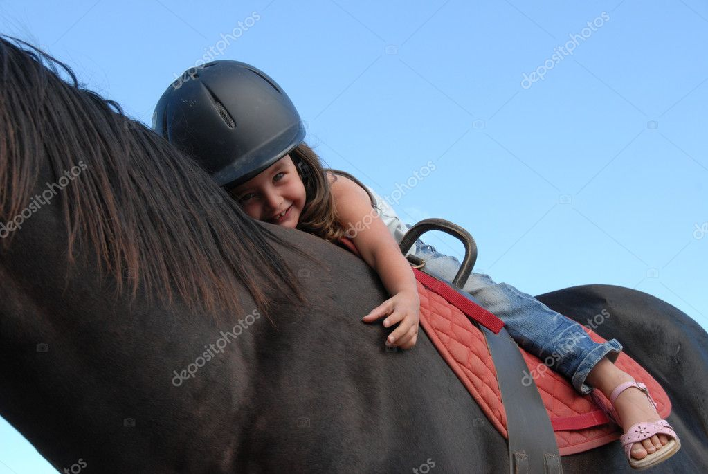 Very young little girl on her black stallion  Stock Photo #2029340