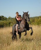 Rearing stallion, teen and child — Stock Photo