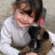 Girl and puppy - Stockfoto
