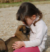 Girl and little dog — Stock Photo