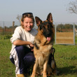 Stock Photo: German shepherd and woman